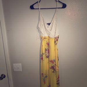 Dresses & Skirts - Yellow floral high low dress.  Junior size